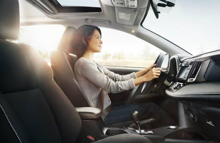 woman driving a 2017 Toyota RAV4