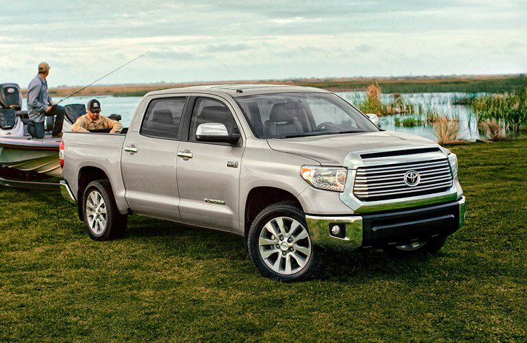 2017 Toyota Tundra towing a boat and parked near a lake