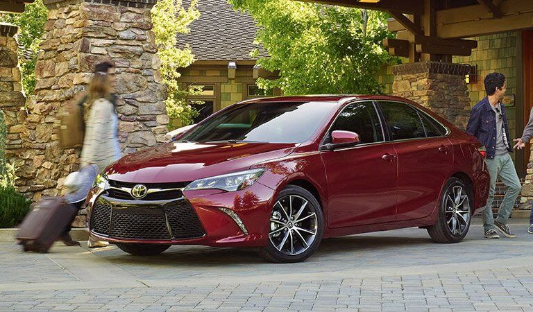 attractive red 2017 Toyota Camry from the side