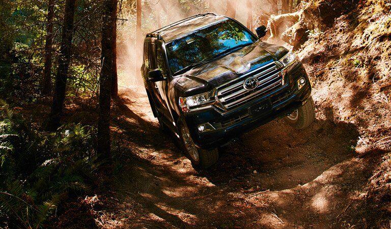 dark Toyota Land Cruiser on an off-road adventure