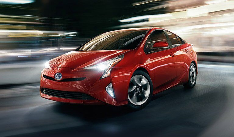 stylistically blurred red Toyota Prius