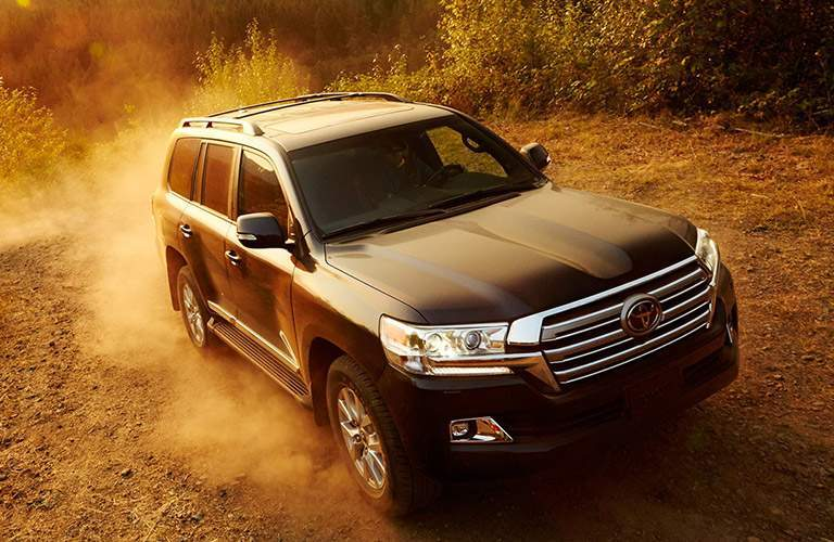 2018 Toyota Land Cruiser driving through sand and dust