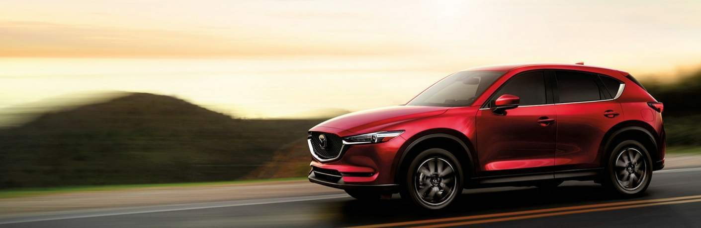 2017 Mazda CX-5 Side View of Red Exterior with Sunset Background