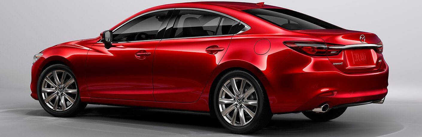 Profile view of red 2018 Mazda6 on silver background