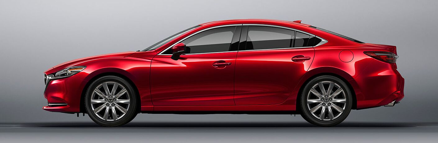 Red 2018 Mazda6 positioned in front of silver background