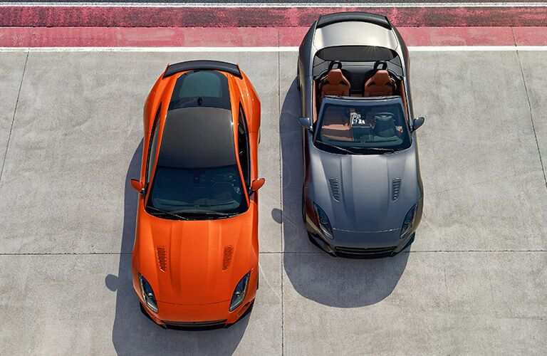 An orange and grey 2017 Jaguar F-type SVR side by side with shadows