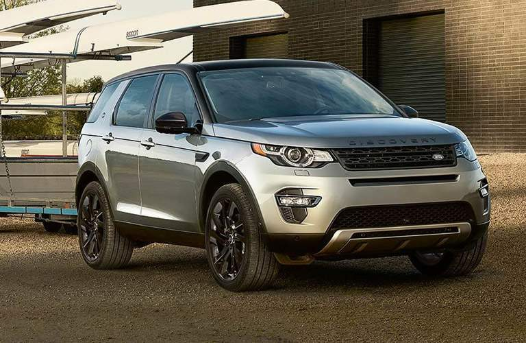 2017 Land Rover Discovery Sport parked dramatically near some boats