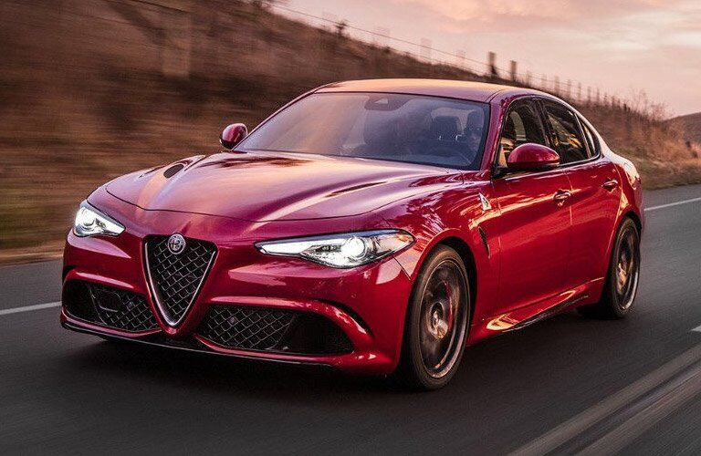 red Alfa Romeo Giulia Quadrifoglio on the road