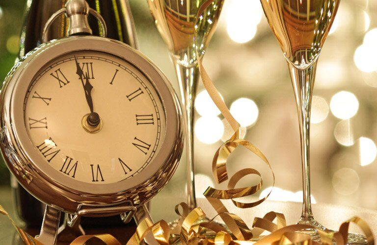 clock and wine glasses with a gold aesthetic