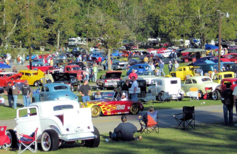 many brightly-colored vehicles at a car show