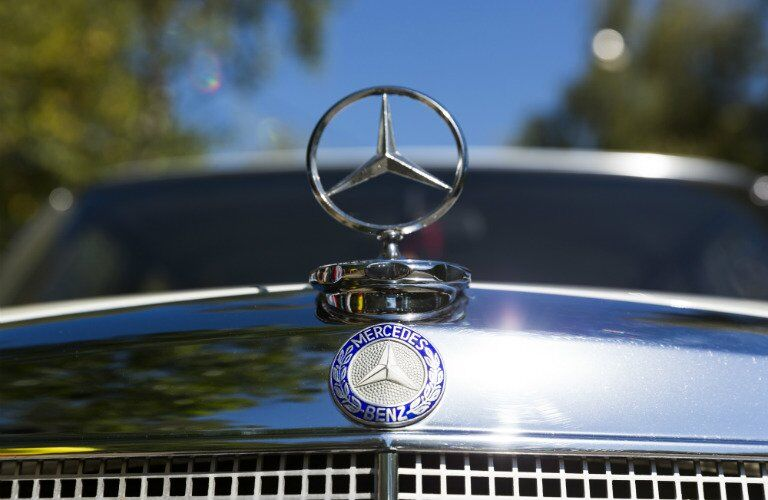 front of an older Mercedes-BEnz vehicle