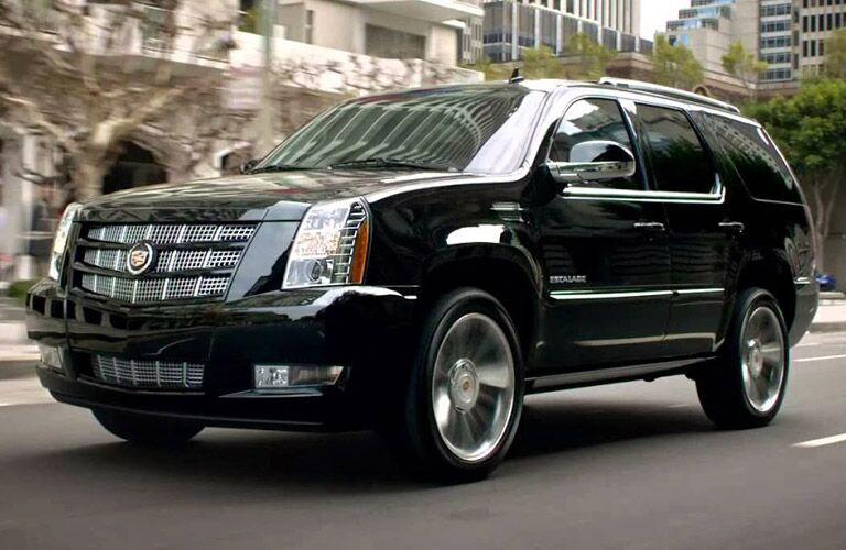 Black Cadillac Escalade driving through an urban area