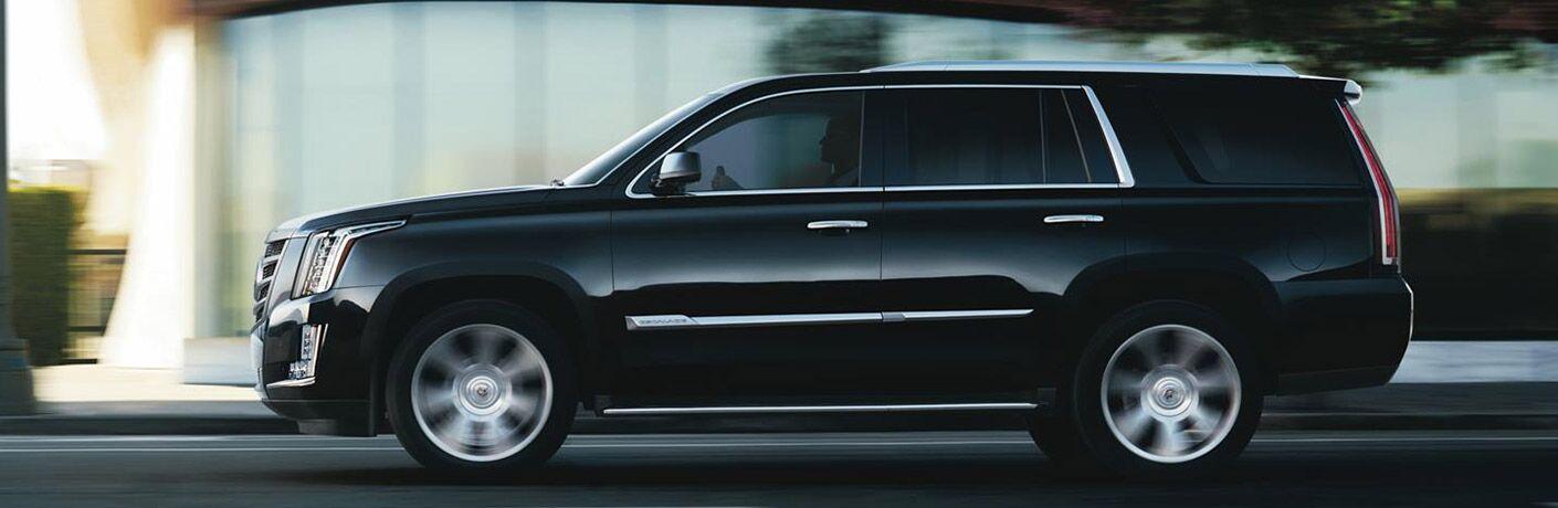 Side profile of black Cadillac Escalade