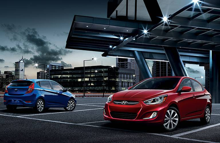 blue hyundai accent and red hyundai accent