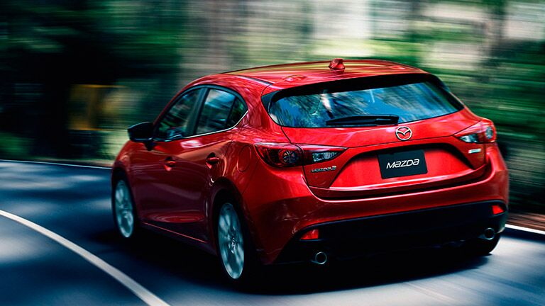 2016 Mazda3 speeding down the road