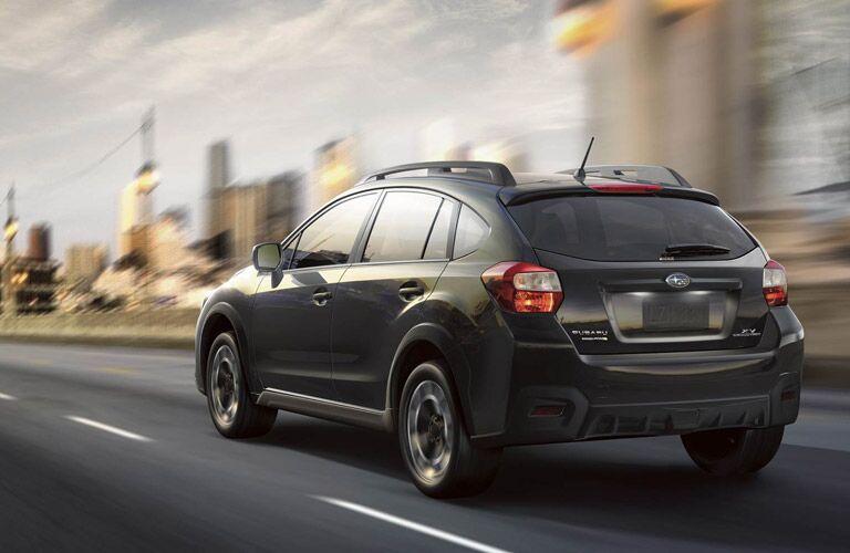 Black Subaru Crosstrek heading for the city