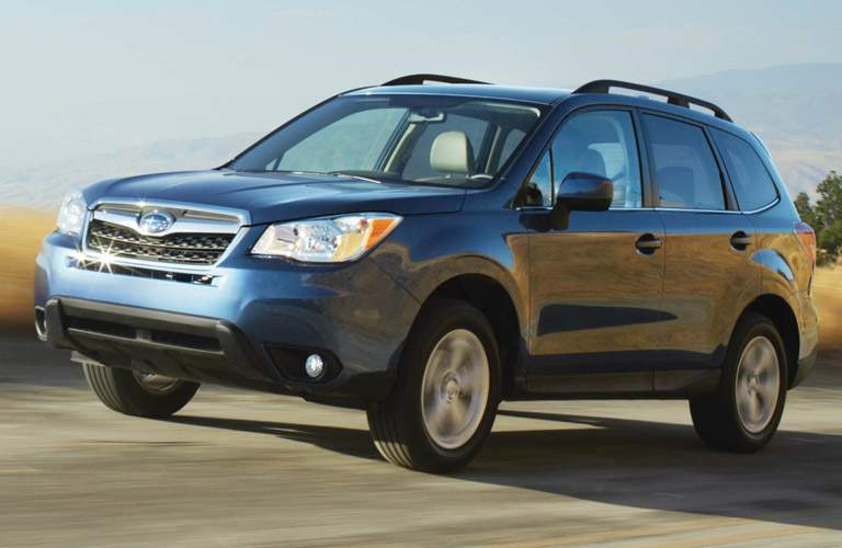 2016 subaru forester on the side of a hill in the desert driving