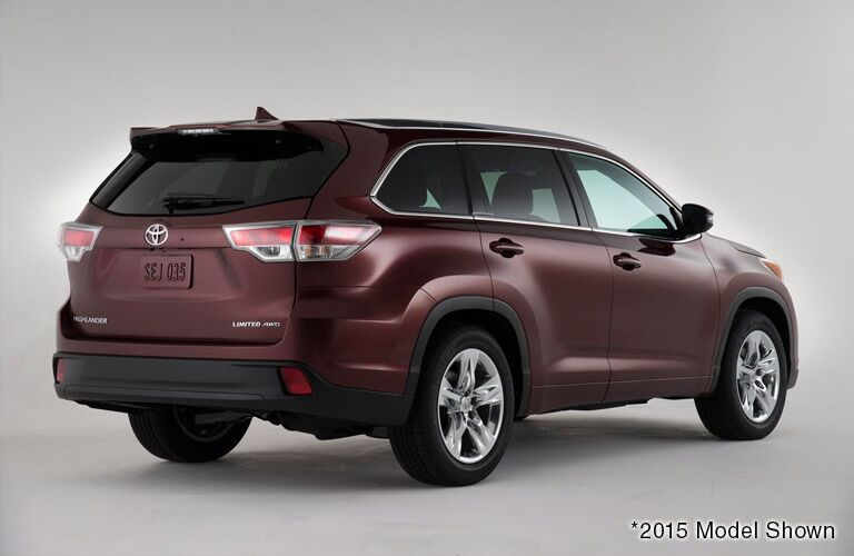 Rear exterior view of a red 2016 Toyota Highlander