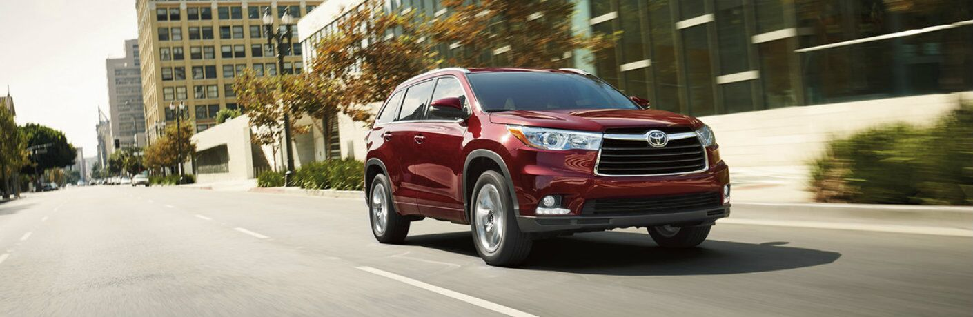 Front passenger side exterior view of a red 2016 Toyota Highlander
