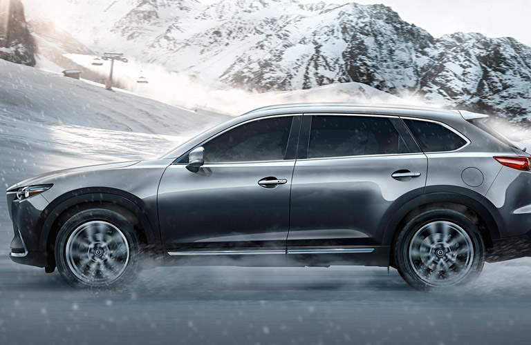 2017 mazda cx-9 in silver on mountain with snow covering it