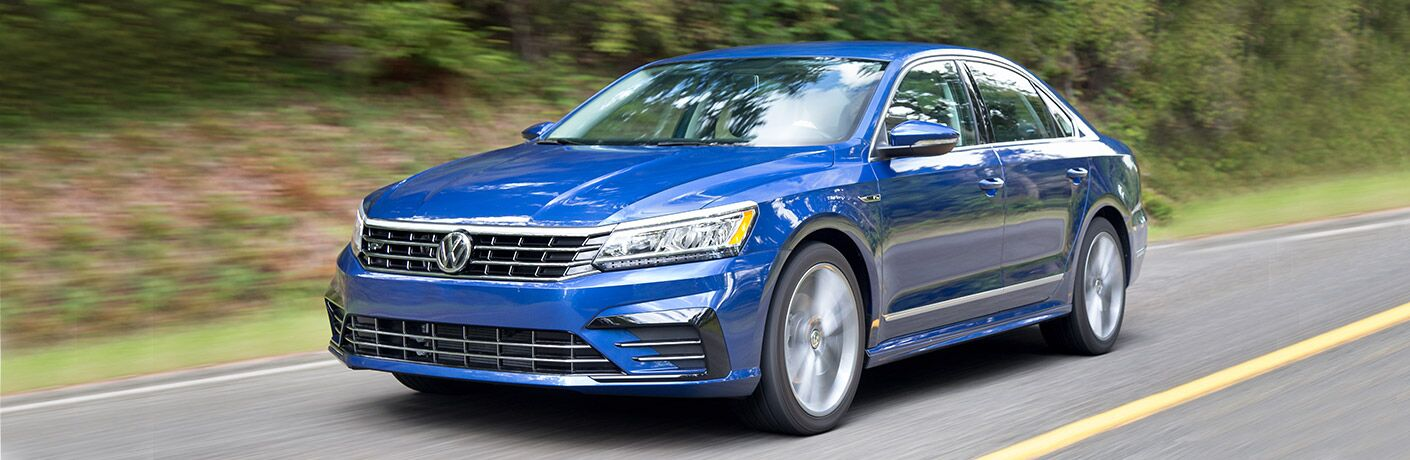 Blue 2018 Volkswagen Passat driving down a highway