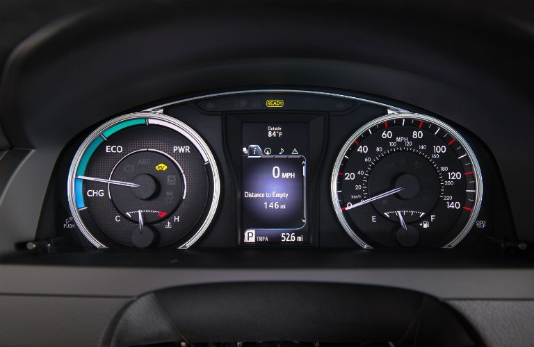 A photo of the center gauge cluster in the Toyota Camry Hybrid.