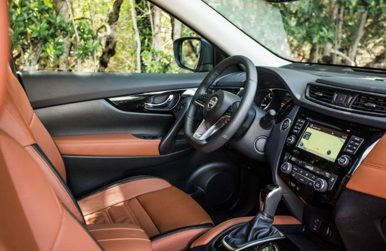 An interior photo of the driver's cockpit in the used Nissan Rogue.