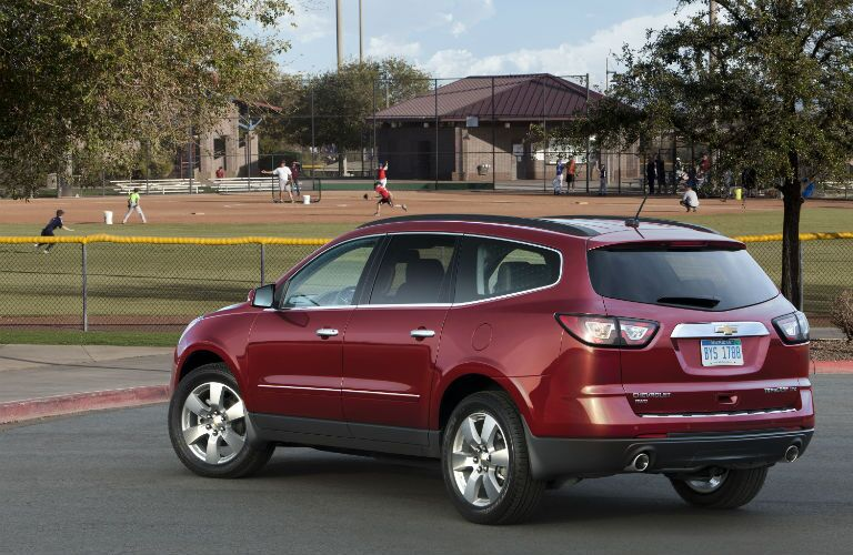 A rear left quarter photo of the used Chevy Traverse.