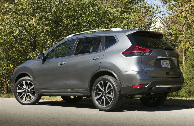 A left profile photo of the used Nissan Rogue.
