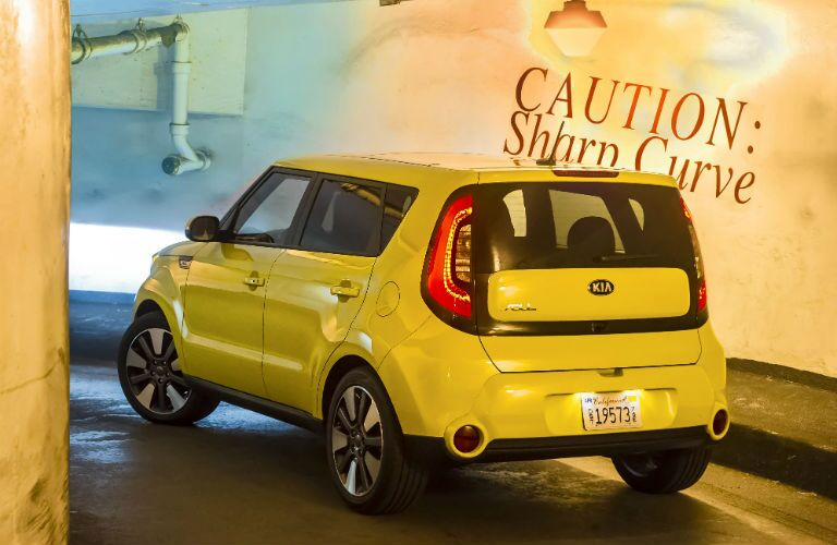 A rear left quarter photo of the used Kia Soul leaving a parking garage.