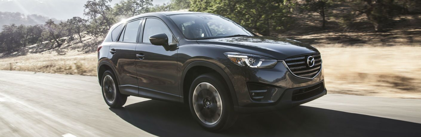 A right front quarter photo of the Mazda CX-5 on the road.
