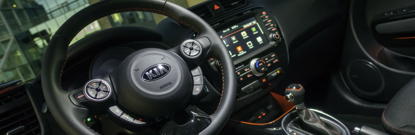 A photo of the driver's cockpit in a version of the used Kia Soul available at Auction Direct USA.