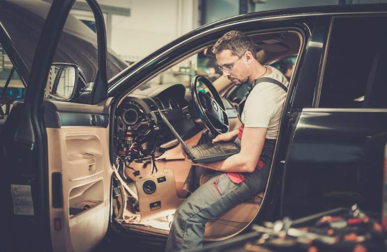 Technician Using Diagnostic Computer to Fix Car