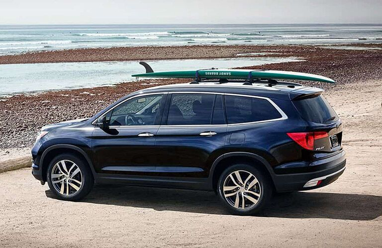 2018 honda pilot parked by beach with surf board