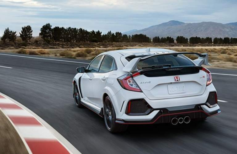 2018 honda civic type r white orchid track driving rear view
