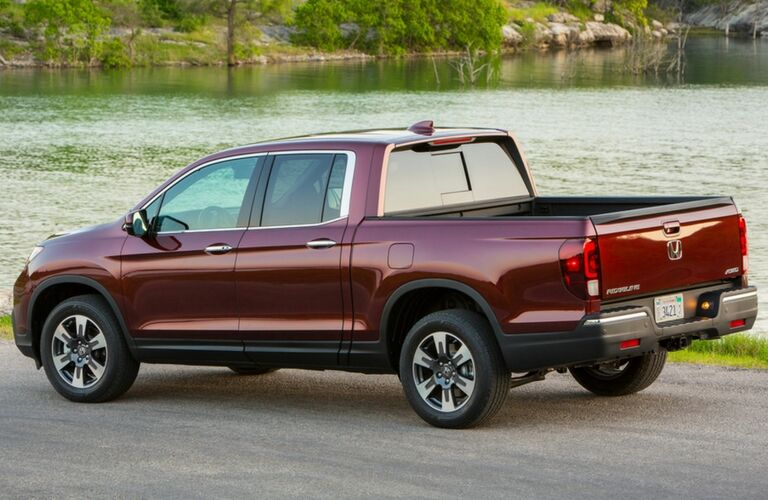 2019 honda ridgeline rear view by water parked