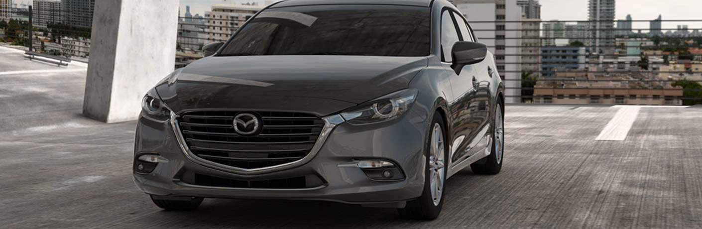 2018 Mazda3 sedan in parking ramp exterior front view