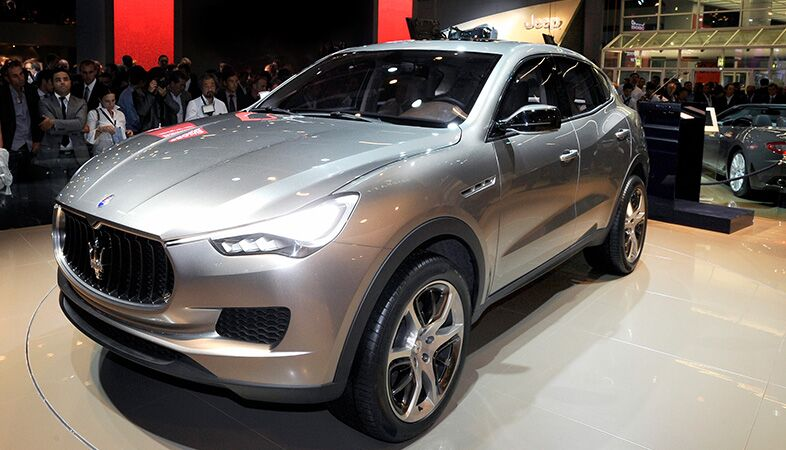 full view of the 2018 maserati levante at an auto show with a  crowd looking at it