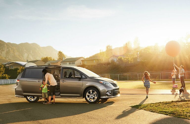 Silver 2016 Toyota Sienna Exterior at the Park with Kids