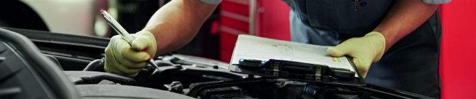 Toyota Technician Checking Engine Bay