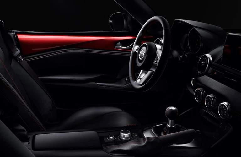 Driver's seat and steering wheel of 2018 Mazda MX-5 Miata