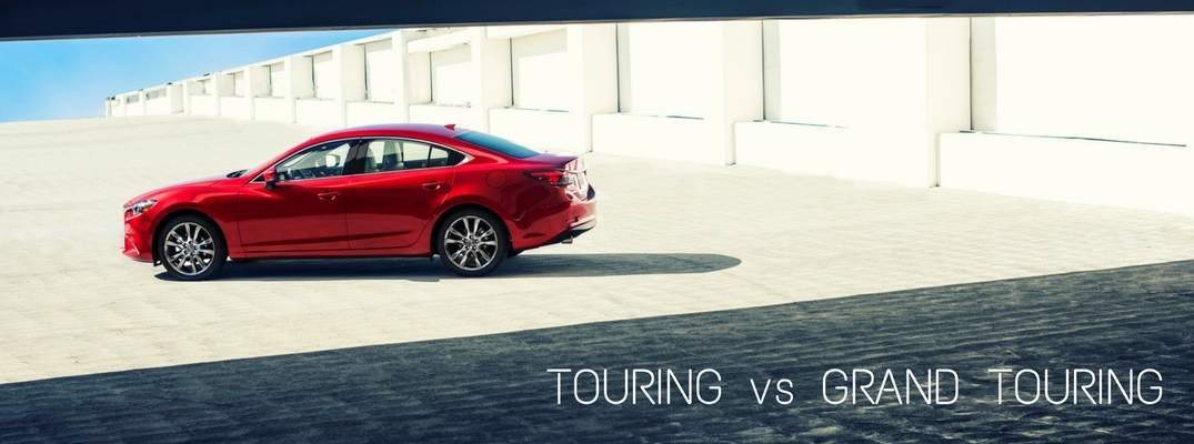 2017 Mazda6 on concrete with text saying Touring vs Grand Touring