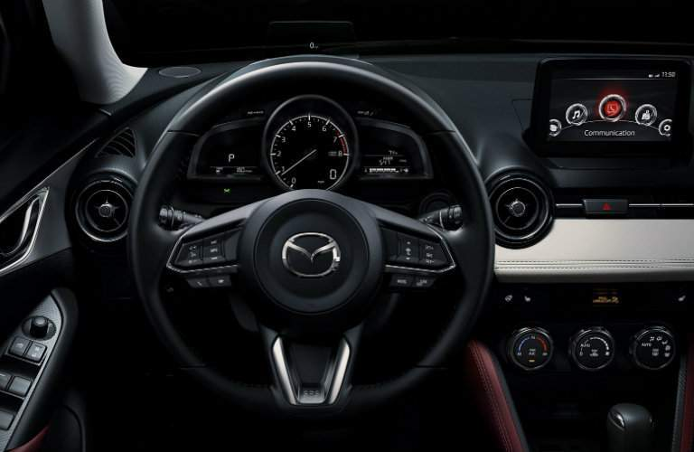 Steering wheel and dashboard display in 2018 Mazda CX-3