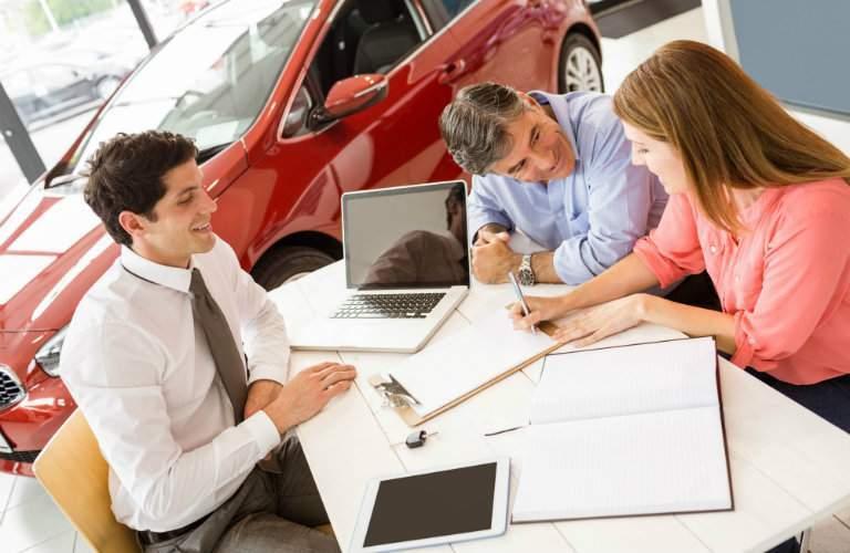 couple buying used car