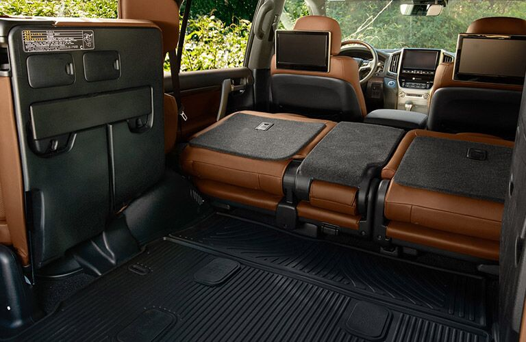 Rear seats folded down inside 2018 Toyota Land Cruiser to reveal cargo volume