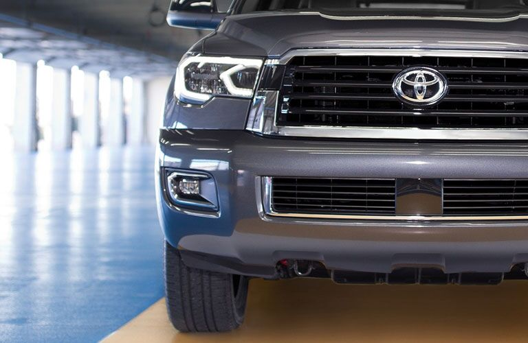 Front shot of 2018 Toyota Sequoia badge and headlight