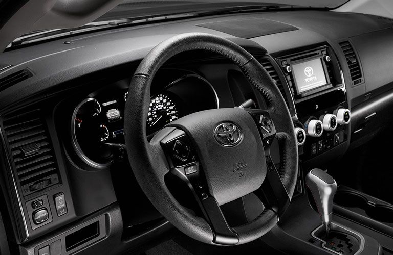 Steering wheel and gear shifter of 2018 Toyota Sequoia with touchscreen interface shown
