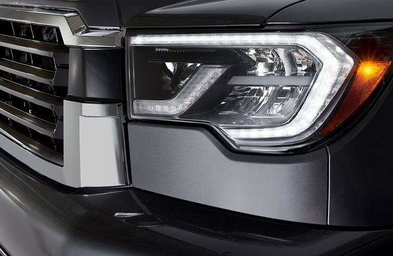Isolated shot of 2018 Toyota Sequoia headlight and grille