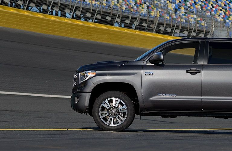 Profile view of gray 2018 Toyota Tundra parked on track