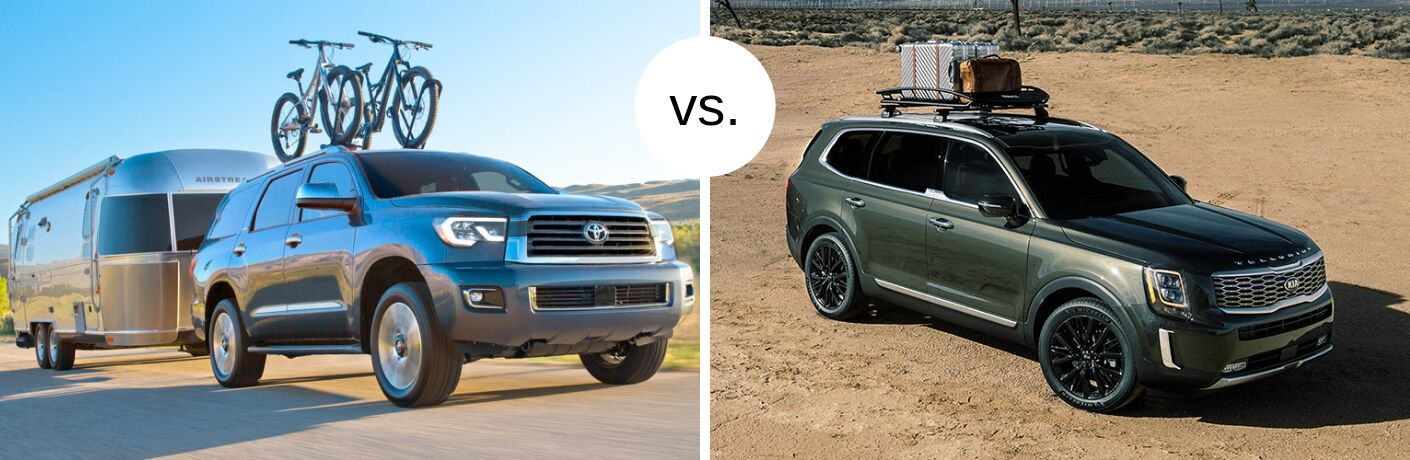 Toyota Sequoia and Kia Telluride models next to each other